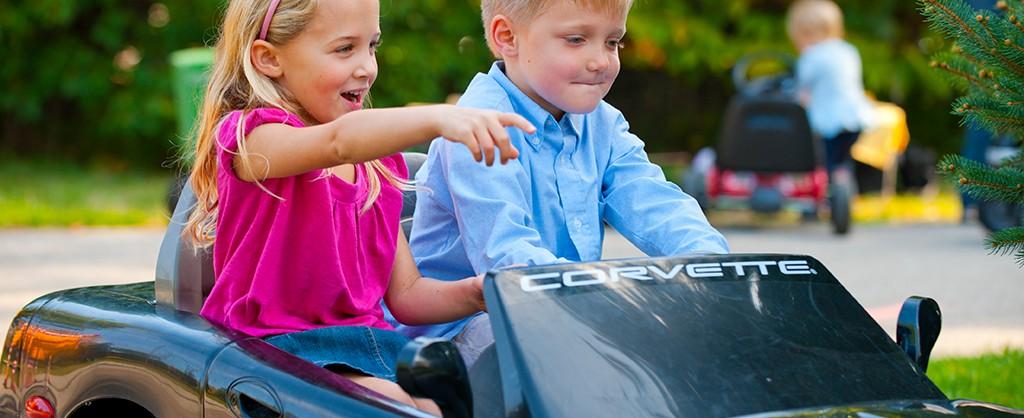 2 kids in toy corvette