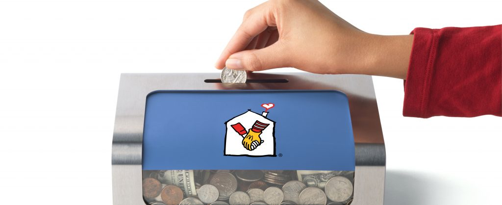 RMHC Donation Box with Woman Hand putting coin in box