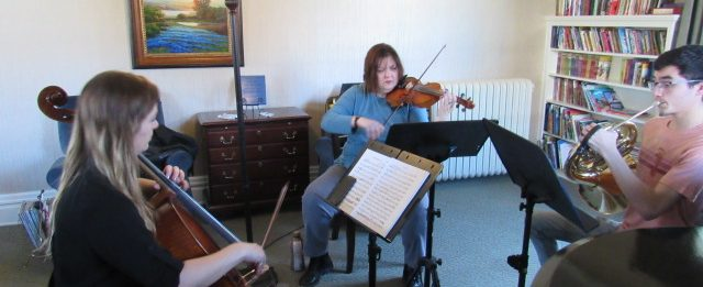 A music ensemble plays for families at the Ronald Mcdonald House.
